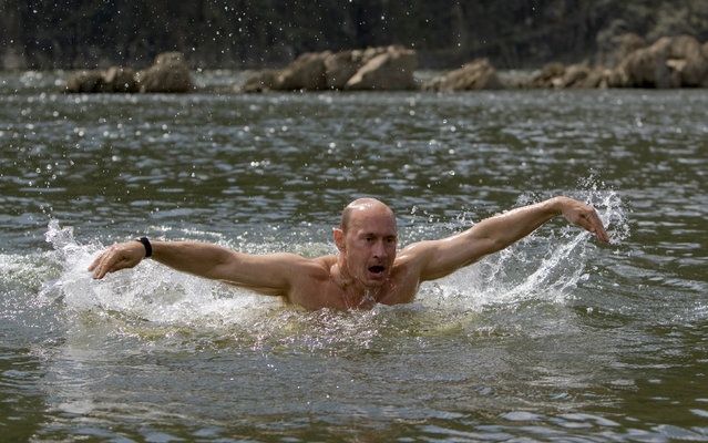 Russia's Prime Minister Vladimir Putin swims in a lake in southern Siberia's Tuva region August 3, 2009. (Photo by Alexei Druzhinin/Reuters/RIA Novosti)