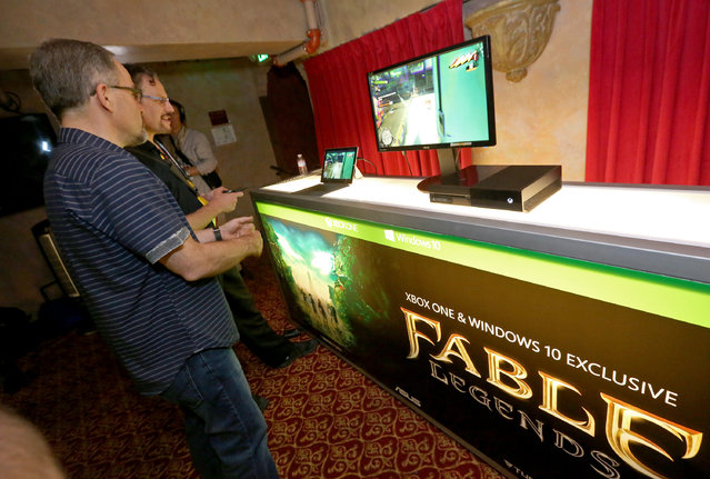 Gamers check out game streaming with the Xbox App on Windows 10 at the Xbox-sponsored PC Gaming Show at E3 in Los Angeles on Tuesday, June 16, 2015. (Photo by Casey Rodgers/Invision for Microsoft/AP Images)