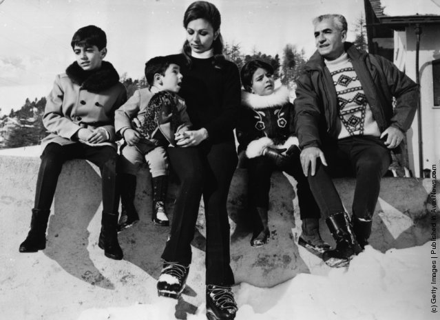 1969: Mohammad Reza Pahlavi, the Shah of Persia, on holiday in St Moritz with his family; (left to right) Prince Reza (aged 8), Prince Ali Reza (aged 2), Empress Farah Diba, Princess Farahnaz (aged 5) and the Shah