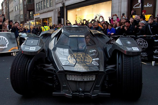 """The """"Batmobile"""" arrives at the finish line as Gumball Rally closes down Regent Street at Regent Street on May 3, 2016 in London, England. (Photo by Ben A. Pruchnie/Getty Images)"""