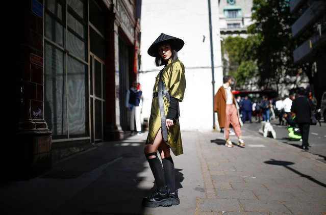 Fashionista poses for photographers during London Fashion Week in London, Britain, September 13, 2019. (Photo by Henry Nicholls/Reuters)