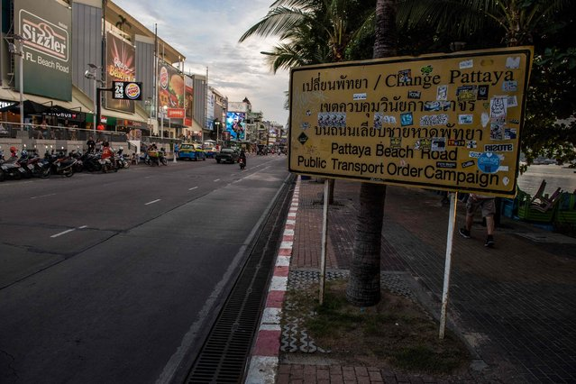 This photo taken on March 29, 2017 shows a road sign announcing a public transport order campaign covered with stickers, along Beach Road in Pattaya. (Photo by Roberto Schmidt/AFP Photo)