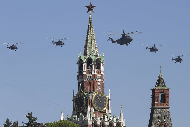 Russian Air Force helicopter Mi-26, center, with Mi-8, flies over Red Square during a Victory Day parade in Moscow. (Photo by Denis Tyrin/AP Photo)