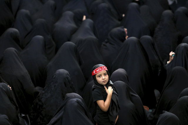 Muslim Shiite women attend a mourning ceremony five days ahead of Ashoura, at the Sadat Akhavi Mosque, in Tehran, Iran, Thursday, September 5, 2019. Ashoura is the annual Shiite Muslim commemoration marking the death of Hussein, the grandson of the Prophet Muhammad, at the Battle of Karbala in present-day Iraq in the 7th century. (Photo by Ebrahim Noroozi/AP Photo)