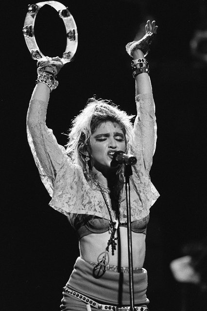 """American singer Madonna performs on """"The Virgin Tour"""" at Radio City Music Hall in New York City on June 6, 1985. (Photo by Frank Micelotta/ImageDirect)"""