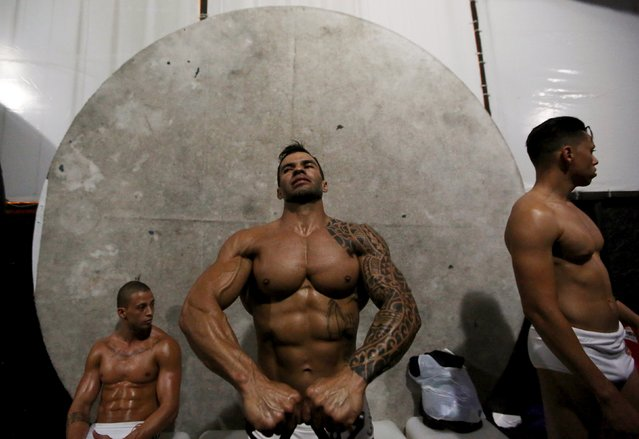 Competitors warm up during the 2015 Brazil Miss and Mister Fitness contest in Sao Paulo, Brazil, June 18, 2015. (Photo by Paulo Whitaker/Reuters)