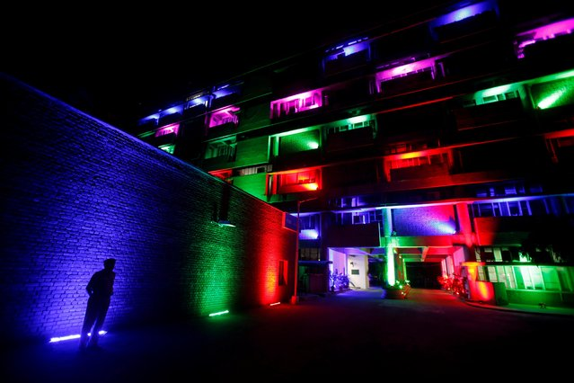 A policeman stands in front of the secretariat building illuminated by colourful lights during Diwali, the Hindu festival of lights, celebrations in Chandigarh, India, October 27, 2019. (Photo by Ajay Verma/Reuters)