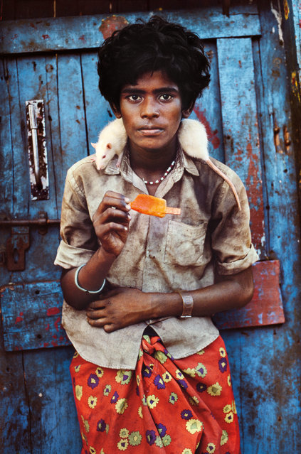 A teenage boy with an albino rat, Chennai, India, 1996. (Photo by Steve McCurry/The Guardian)