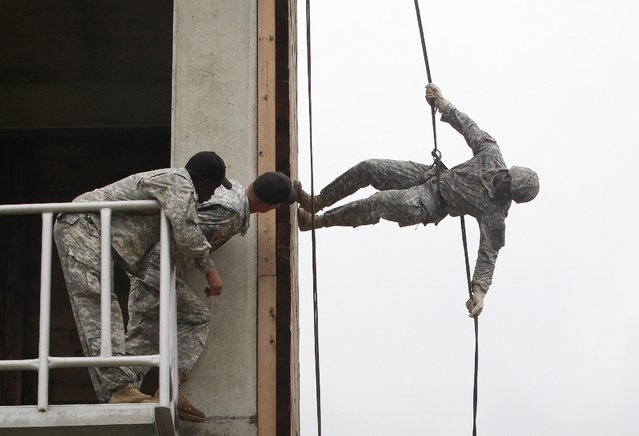 A United States Forces Korea 2nd Infantry Division soldier rappels during a training session at Camp Casey in Dongducheon, South Korea, Friday, July 24, 2015. About 200 U.S. soldiers from the 2nd Infantry Division located in South Korea took part in the 12-day course focused on combat assault operations involving U.S. Army rotary-wing aircraft. (Photo by Ahn Young-joon/AP Photo)