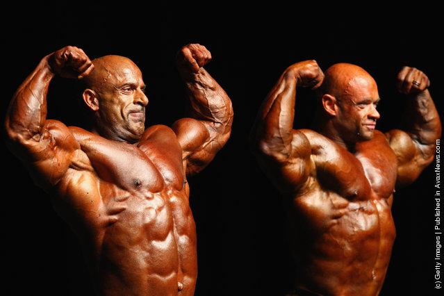 Michael Kefalianos of Australia and Branch Warren of the USA pose during pre judging for the 2012 IFBB Australian Pro Grand Prix XII at The Plenary