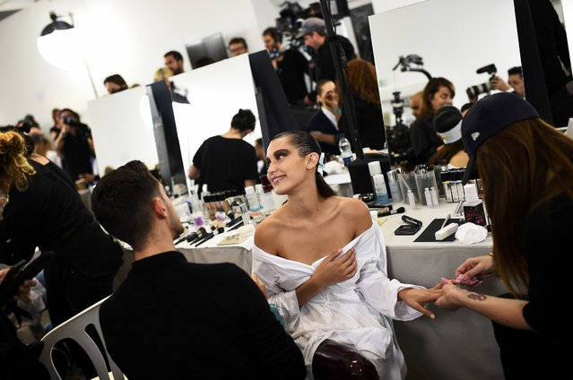 Model Bella Hadid has her nails and make-up done inside Blenheim Palace ahead of a fashion show presenting the Dior, Cruise 2017 Collection, in Woodstock, Britain May 31, 2016. (Photo by Dylan Martinez/Reuters)