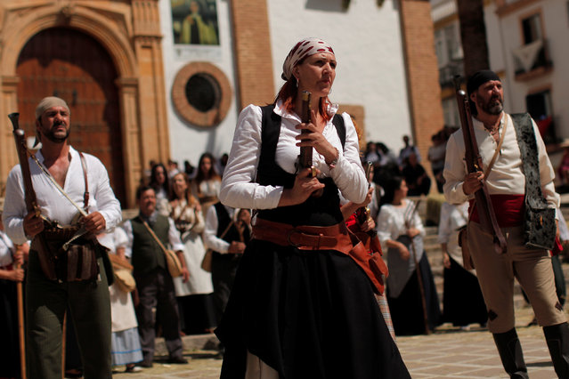 """Members of a historical battle re-enactment group, dressed as bandits, participate in a Spanish Independence War battle re-enactment during the fifth edition of """"Ronda Romantica"""" (Romantic Ronda) in Ronda, southern Spain, May 27, 2017. Ronda Romantica is a cultural, historical and tourist event during the four days where thousands of people of Ronda and about fifty towns around of """"Serrania de Ronda"""" (Ronda Mountain Ranges), dressed in traditional costumes, recreate the era of the bandits, drovers and romantic travelers in the nineteenth century. They also recreate the war of Spanish Independence which started in 1808 with the invasion by French Napoleonic troops and lasted until 1814, when the French were defeated and expelled from the country. (Photo by Jon Nazca/Reuters)"""