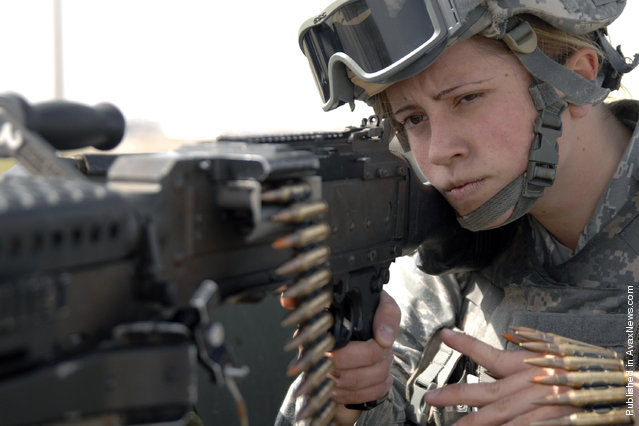 Airman Samantha Allred peers down the barrel of a M240B machine gun while working patrol on the flightline March 9 at Incirlik Air Base, Turkey. Airman Allred, with her fellow 39th Security Forces Squadron personnel, is responsible for providing security for the U.S. Air Forces in Europe's largest weapon's storage area. Women's History Month is celebrated throughout March to highlight American women of the past, present and future, and their accomplishments throughout the years
