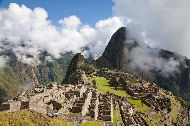 Incan ruins of Machu Picchu with Huayna Picchu in background. (Photo by Lonely Planet Images)