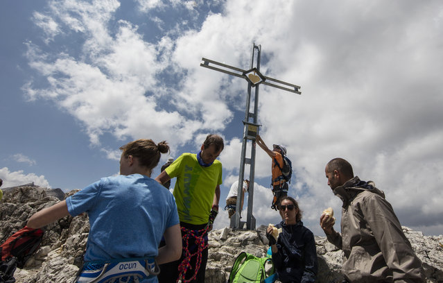 Climbers stand on the peak of Piz Da Lech in the Dolomite Mountains near the town of Corvara in northern Italy July 20, 2015. (Photo by Bob Strong/Reuters)