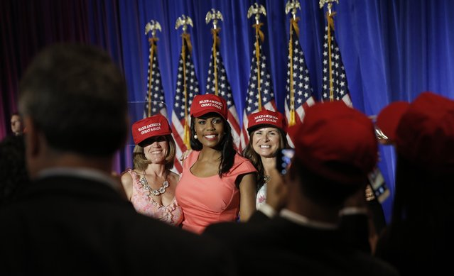 """Theresa """"Omarosa"""" Manigault, of Republican U.S. presidential candidate Donald Trump's reality TV show """"The Apprentice"""", poses with other Trump supporters as they await his arrival at a campaign event on the day that several states held presidential primary elections, including California, at the Trump National Golf Club Westchester in Briarcliff Manor, New York, U.S., June 7, 2016. (Photo by Mike Segar/Reuters)"""