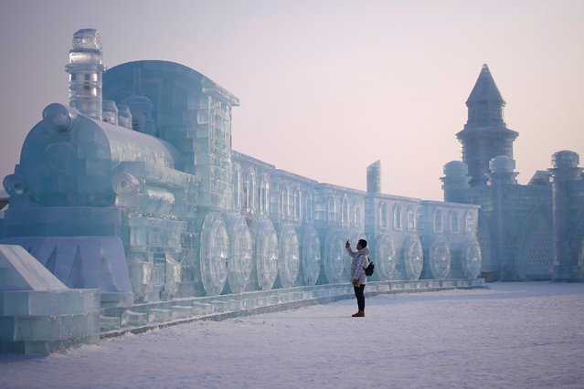 A man visits ice sculptures ahead of the annual Harbin International Ice and Snow Sculpture Festival in the northern city of Harbin, Heilongjiang province, China on January 4, 2020. (Photo by Aly Song/Reuters)
