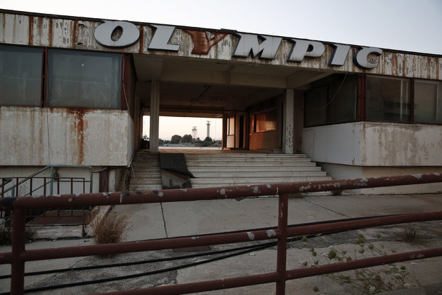 The Olympic Airways logo is seen on a building at the former Athens International airport, Hellenikon June 16, 2014. (Photo by Yorgos Karahalis/Reuters)