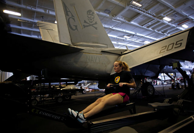 A US Navy sailor works out in the hangar of the USS Harry S. Truman aircraft carrier in the eastern Mediterranean Sea, June 13, 2016. (Photo by Baz Ratner/Reuters)