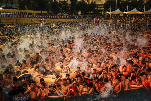 Heat wave hits China – tourists crowd a water park in Wuhan city, central China's Hubei province on July 15, 2017. (Photo by Imaginechina/Rex Features/Shutterstock)
