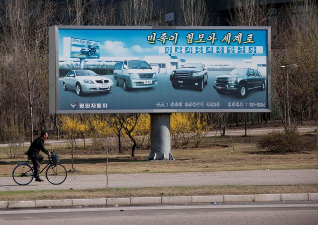 Ironically, the only advertising billboards you can see in Pyongyang are about... cars! (Photo by Eric Lafforgue/Exclusivepix Media)