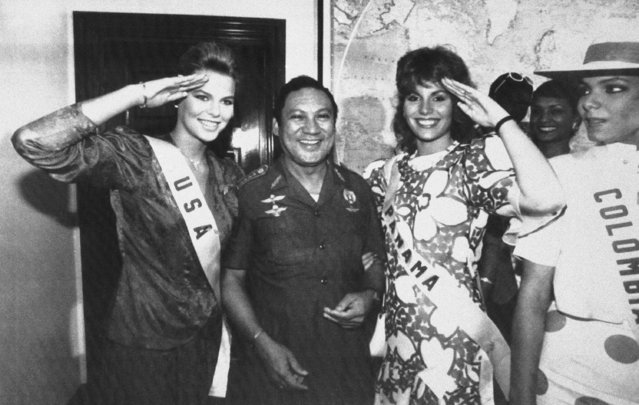 In this July 5, 1986 file photo, Miss USA, Christy Fichtner, left, and Miss Panama, Gilda Garcia Lopez, salute while flanking General Manuel Antonio Noriega in Panama City. Pictured right is Miss Colombia, Maria Monica Urbina. A source close to the family of former Panamanian dictator Manuel Noriega said Monday, May 29, 2017, that he has died at age 83. (Photo by Jim Ellis/AP Photo)