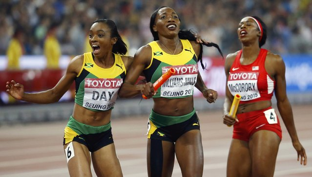 Christine Day of Jamaica (L) and teammate Novlene Williams-Mills celebrate after crossing the finish line in the women's 4 x 400 metres relay final during the 15th IAAF World Championships at the National Stadium in Beijing, China, August 30, 2015. (Photo by Damir Sagolj/Reuters)