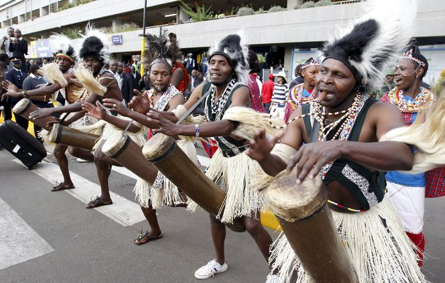 Traditional Chuka drummers celebrate as they welcome the national athletics team at the Jomo Kenyatta airport in Nairobi, Kenya, September 1, 2015, after they topped the medals table at the recently concluded 15th International Association of Athletics Federations (IAAF) World Championships at the National Stadium in Beijing, China. (Photo by Thomas Mukoya/Reuters)