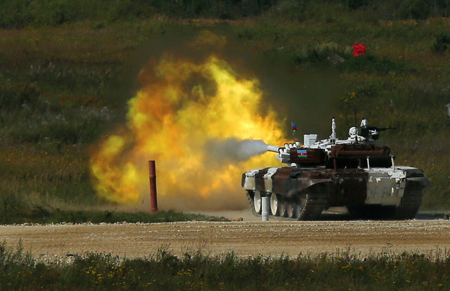 A T-72 tank, operated by a crew from Azerbaijan, fires at a target during the Tank Biathlon competition, part of the International Army Games 2016, at a range in the settlement of Alabino outside Moscow, Russia, August 2, 2016. (Photo by Maxim Shemetov/Reuters)