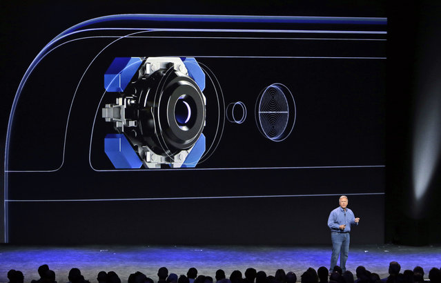Phil Schiller, Apple's senior vice president of worldwide product marketing, discusses the camera features on the new iPhone 6 and iPhone 6 plus on Tuesday, September 9, 2014, in Cupertino, Calif. (Photo by Marcio Jose Sanchez/AP Photo)