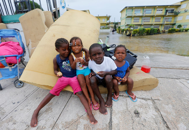 Children pose as they leave a school used as a shelter, after Hurricane Earl hit, in Belize City, Belize August 4, 2016. (Photo by Henry Romero/Reuters)