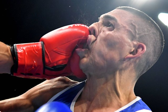 France's Sofiane Oumiha (L) lands a punch on Honduras' Teofimo Andres Lopez Rivera during the Men's Light (60kg) match at the Rio 2016 Olympic Games at the Riocentro – Pavilion 6 in Rio de Janeiro on August 7, 2016. (Photo byYuri Cortez /AFP Photo)