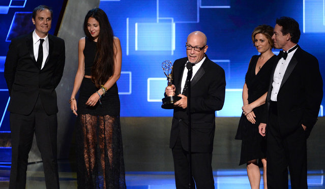 "The team for  ""Going Clear: Scientology And The Prison of Belief"" accepts the award for outstanding writing for nonfiction programming at the Television Academy's Creative Arts Emmy Awards at Microsoft Theater on Saturday, September 12, 2015, in Los Angeles. (Photo by Phil McCarten/Invision for the Television Academy/AP Images)"
