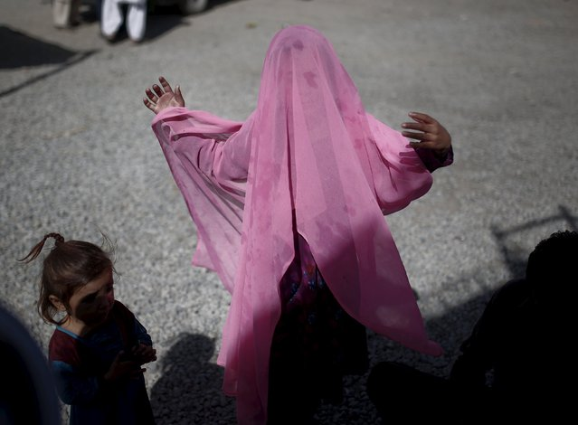 An Afghan refugee girl adjusts her scarf after she arrives at a United Nations High Commissioner for Refugees (UNHCR) registration centre in Kabul, Afghanistan September 2, 2015. A growing number of Afghan refugees are making the journey back from Pakistan with trepidation, as militant violence intensifies, yet feeling shunned by their adopted country as relations between the neighbours sour. (Photo by Ahmad Masood/Reuters)