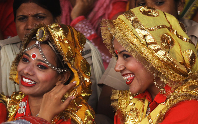 Participants share a moment after performing at a cultural program during India's Independence Day celebrations in Ajmer, in the desert state of Rajasthan, India, August 15, 2016. (Photo by Himanshu Sharma/Reuters)