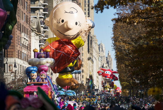 A Charlie Brown balloon moves along Central Park West during the Macy's Thanksgiving Day Parade in New York, Thursday, November 23, 2017. (Photo by Craig Ruttle/AP Photo)
