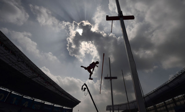 Japan's Akihiko Nakamura competes in the men's decathlon pole vault athletics event during the 17th Asian Games at the Incheon Asiad Main Stadium in Incheon on October 1, 2014. (Photo by Manan Vatsyayana/AFP Photo)