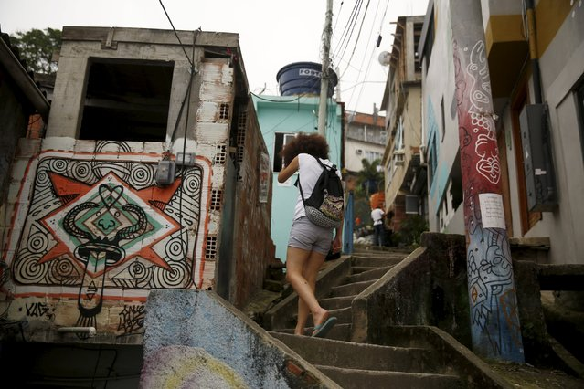 Tulin Hashemi, a Syrian, walks up stairs after a job interview in Vidigal slum in Rio de Janeiro, Brazil, September 22, 2015. (Photo by Pilar Olivares/Reuters)