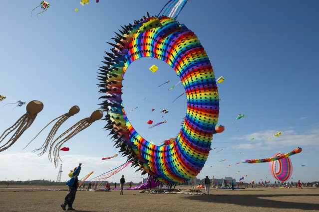 A kite flying contest is held in Nantong, east China's Jiangsu featuring various kites of different shapes on December 20, 2017. (Photo by SIPA Asia/Pacific Press/Barcroft Images)
