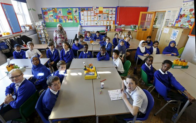 Pupils pose for a photograph in Ms. Yasmin Hussain's year 6 class at Salusbury Primary School in London, Britain, June 25, 2015. (Photo by Suzanne Plunkett/Reuters)