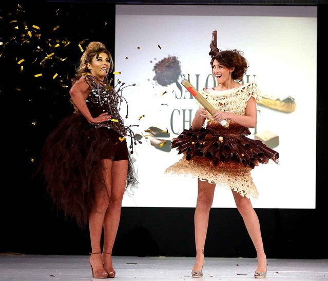 Ariane Brodier and Rachel Legrain-Trapani walk the runway and wears a chocolate costume made by designer and a chocolate maker during the Fashion Chocolate show at Salon du Chocolat at Parc des Expositions Porte de Versailles in Paris, France, October 28, 2014. (Photo by LAURENTVU/SIPA Press)