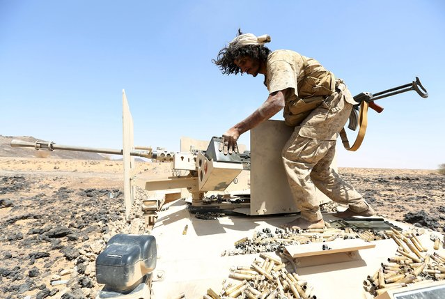 A soldier loyal to Yemen's government stands on a armoured personnel carrier in the frontline province of Marib, October 4, 2015. (Photo by Reuters/Stringer)