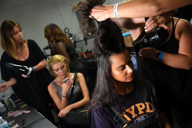 Models prepare backstage at the VFILES fashion show during New York Fashion Week at Spring Studios on September 7, 2016 in New York City. (Photo by Ben Gabbe/Getty Images)