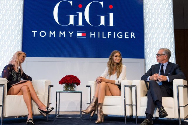 Zanna Roberts Rassi, from left, Gigi Hadid and Tommy Hilfiger appear at the Tommy X Gigi collection launch at the Samuel B. & Davide Rose Building on Friday, September 9, 2016, in New York. (Photo by Michael Zorn/Invision/AP Photo)