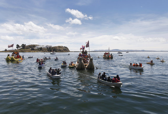Andean actors sail in a totora raft during a re-enactment of the legend of Manco Capac and Mama Ocllo in a Uros island at Lake Titicaca in Puno November 5, 2014. According to an Inca legend, Manco Capac and Mama Occllo emerged from the waters of the lake carrying a golden staff instructed by the sun god Inti to create a temple in the spot where the staff sank into the earth. (Photo by Enrique Castro-Mendivil/Reuters)