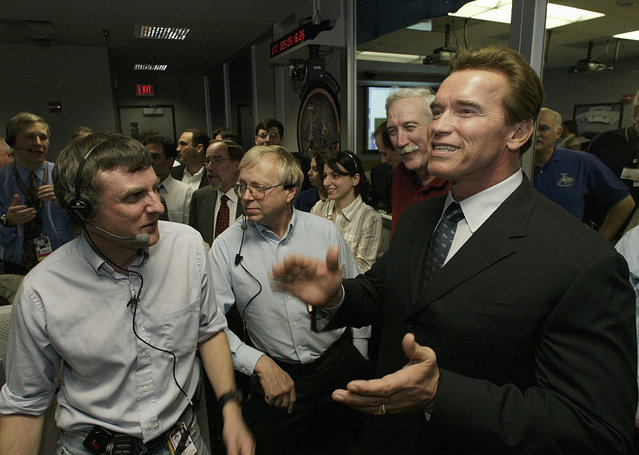 California Gov. Arnold Schwarzenegger cheers with Dr. Steve Squyres, principal investigator for Opportunity, and other Mars rovers team members in the Mission Control Center at NASA's JPL in Pasadena, California, on January 24, 2004., following the safe landing of the Opportunity rover on Mars. (Photo by Damian Dovarganes/AP Photo/Pool/The Atlantic)