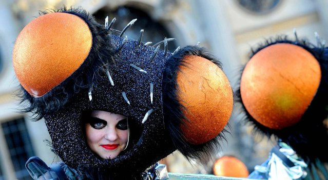 A member of a samba group participates in a parade in Bremen, Germany on February 2, 2013. (Photo by Carmen Jaspersen/DPA)