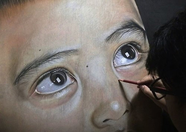Ivan Hoos drawing of a young boy. (Photo by Ivan Hoo/Caters News)