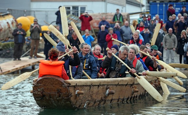 Crew in Britain's first ever full-size reconstructed sea-going Bronze Age boat, paddle out to sea near to the National Maritime Museum as it makes its maiden voyage on March 6, 2013 in Falmouth, England. (Photo by Matt Cardy)