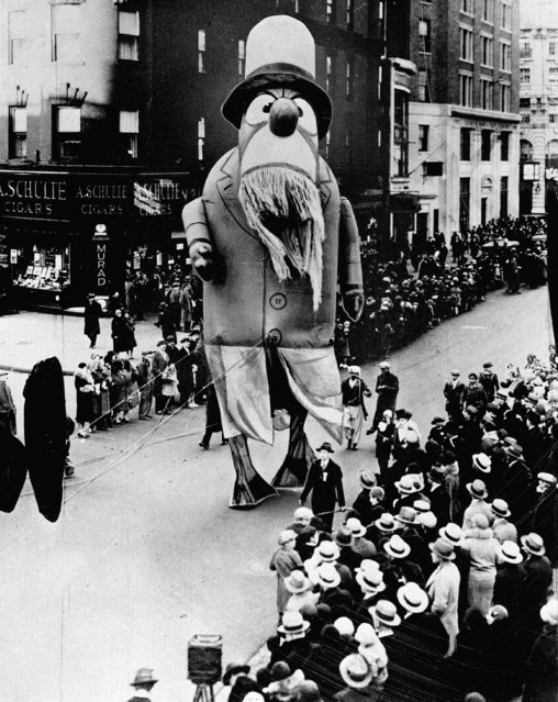 A large outdoor float of Captain Nemo (?) makes its way down the street during the Macy's Thanksgiving Day Parade in New York City, on November 28, 1929. Originally known as the Macy's Christmas Parade, the Thanksgiving Day parade started in 1924. (Photo by AP Photo)